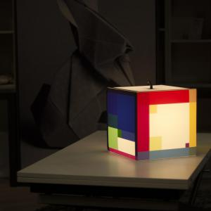 Color out your day light cube lamp on the table with a huge bunny behind it.