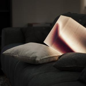 Terrific atmosphere lighting light cube resting on a bed pillow. Brightens up any interrior