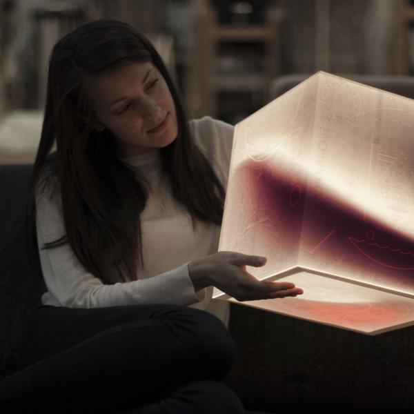 A beautiful, unique ambient mood lamp in a hands of a unique and beautiful girl