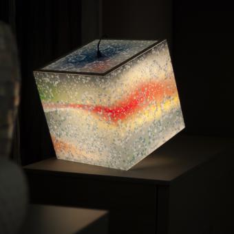 Winter time light cube ambient lamp shining light on a table