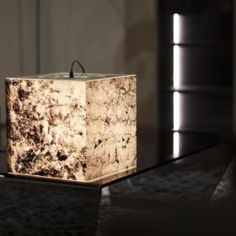 This personalized lamp looks like a marble stone and gives a futuristic look to the interrior design