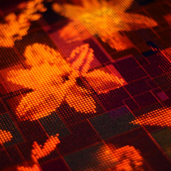 Closeup of summer night light cube lamp. Unique flower pattern