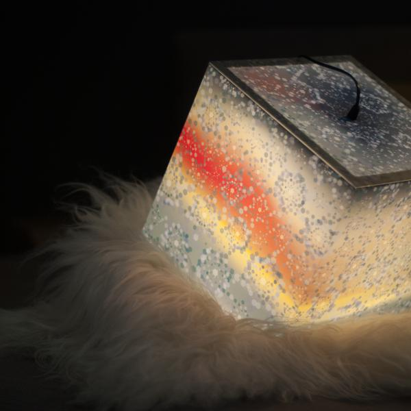 Beutiful ambient light cube lamp with a winter snowflake pattern used as a bedroom lighting
