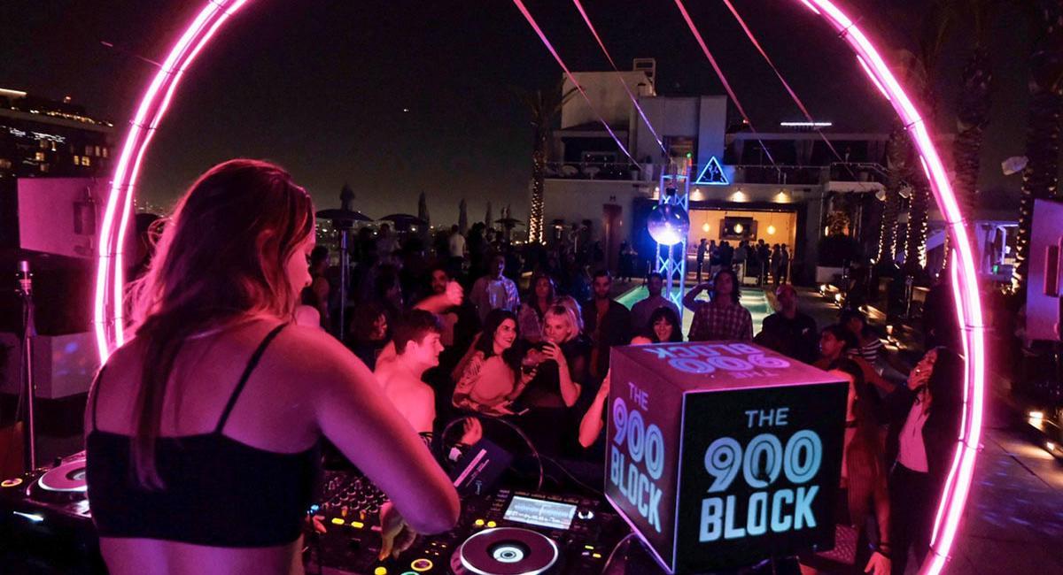Rad music promoters enjoying the power of custom DJ light