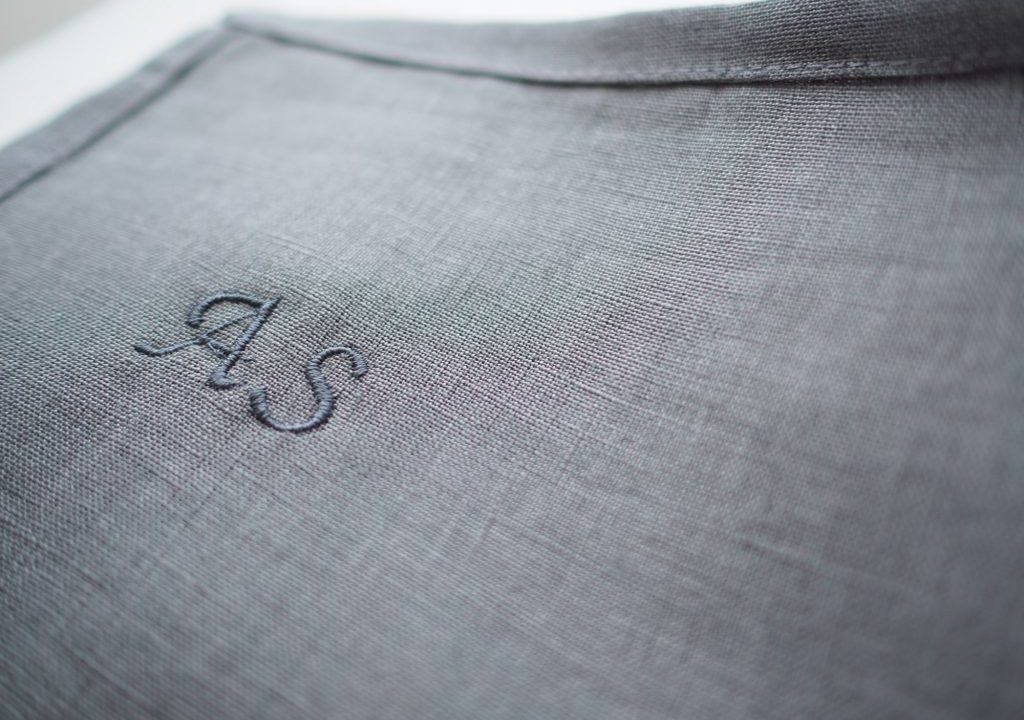 A personalized embroidery on blue linen fabric