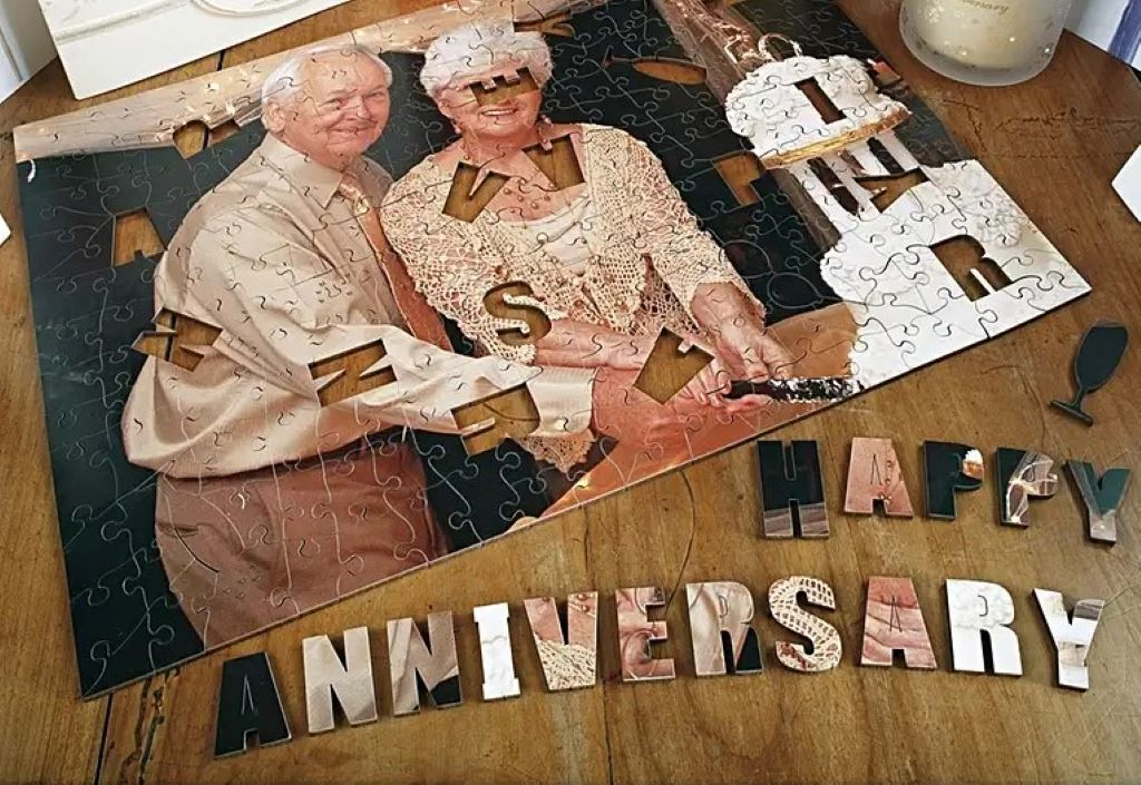 A personalized anniversary gift puzzle showing an elderly couple and a cake