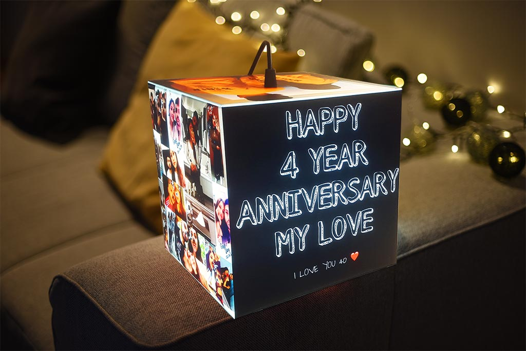 A personalized lamp Uniqcube with anniversary photos