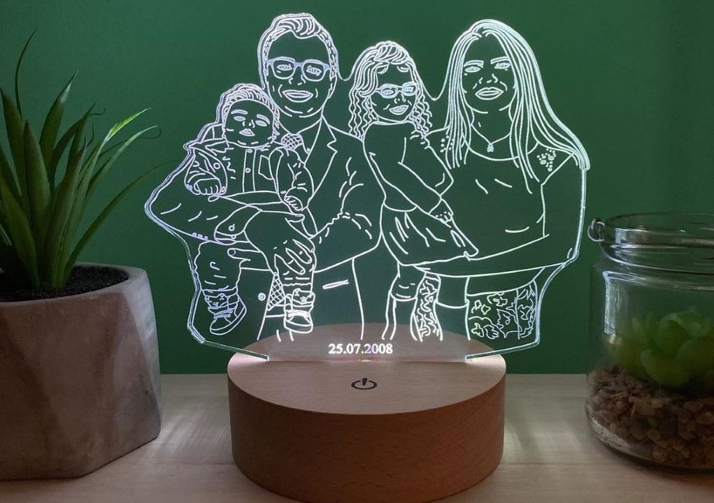 A LED photo lamp depicting a family